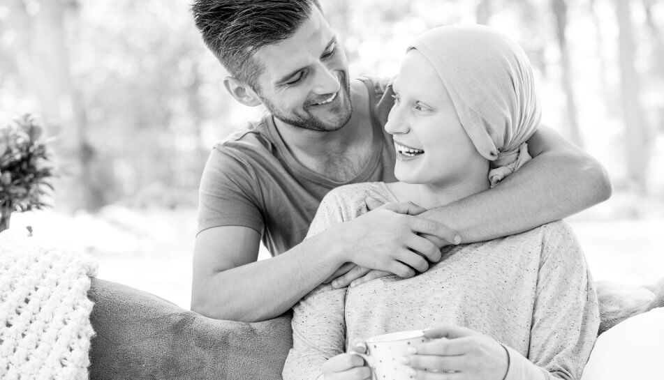 Genetic Analysis of the Tumor Diagnostics. Man hugs woman in the nature.