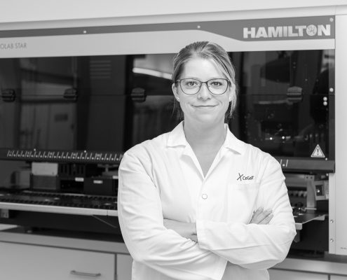 Small RNA Sequencing. Female scientist in front of Hamilton Microlab® STAR.