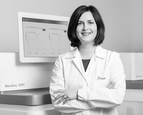 Whole Genome Sequencing. Professional female scientist standing in front of Illumina® NovaSeq 6000 sequencer